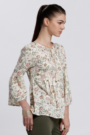 Printed Top with Bell Sleeves and Tie Up Neck