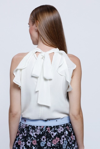 Ruffled Sleeveless Blouse with Pearl Detailing on the Neck