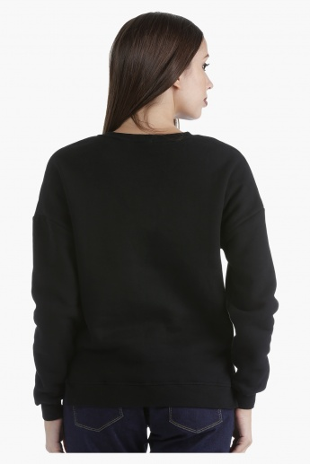 Oversized High-Low Sweater with Badge Applique